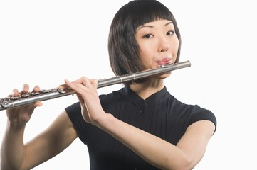 Young Korean woman playing flute
