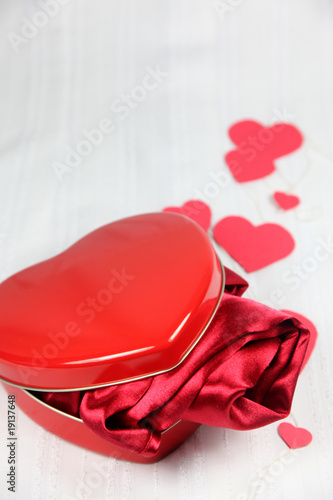 Heart shaped box with a gift