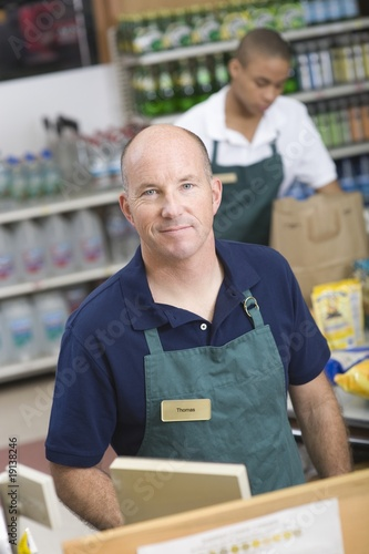 Supermarket employee and check out assistant
