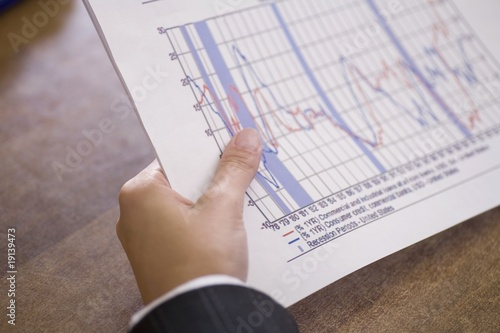 Businessman holds report