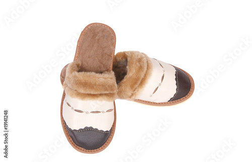 Stylish leather neat slippers on a white.
