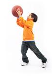 Fototapety Small child playing with basketball