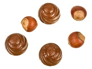 Chocolates and hazelnuts isolated on a white background