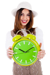 Beautiful young model with hat and showing clock