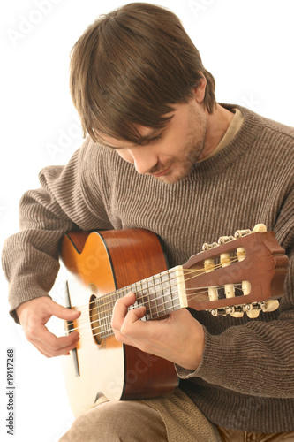 Guitar playing.