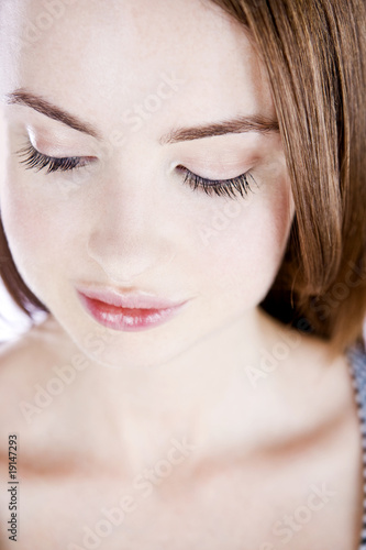 A Close Up Of A Young Woman's Face, Looking Down