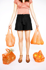 A Young Woman Carrying Heavy Shopping Bags