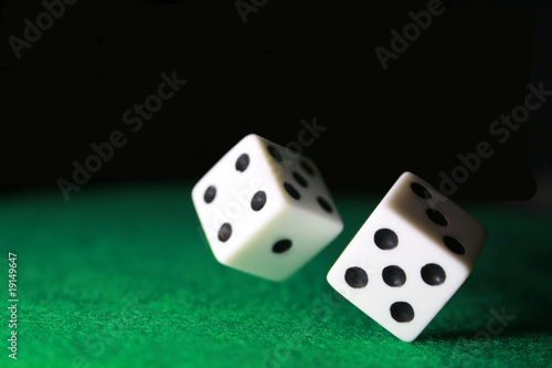 Dice over green felt
