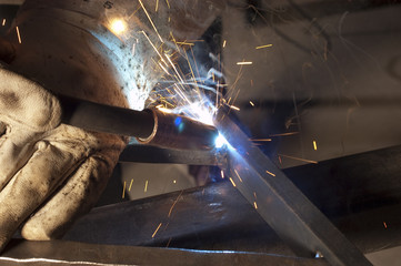 welder welding on decorative handrail