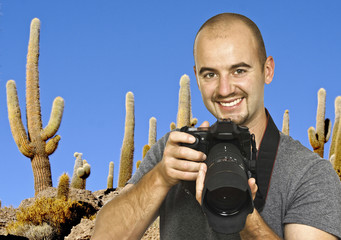 photographer and cactus background