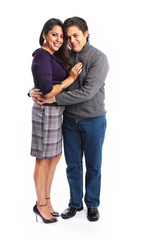 Full body picture of hispanic couple hugging isolated