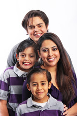 Happy family of four portrait in studio