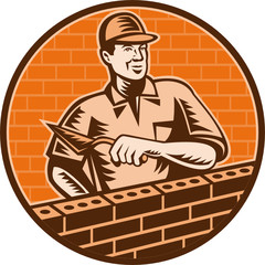Mason worker bricklayer trowel working on brick wall