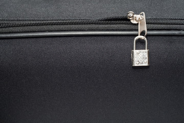 The zipper with lock of a black bag