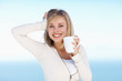 Happy young female holding a cup of coffee , posing