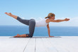 Fit woman doing stretches on a wooden porch