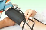 medicine. doctor measures pressure in the patient poster