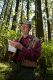 Forester in a Pacific Northwest forest poster