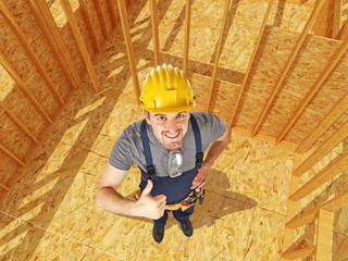 positive carpenter in construction site