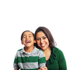 Happy mother and son laughing dressed in green