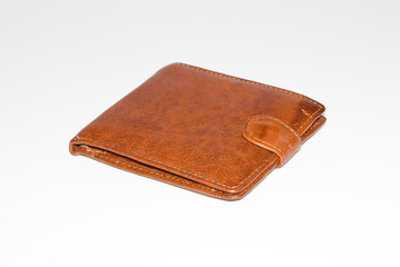 Wallet is leather, brown