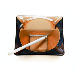 Ash-tray and cigarette