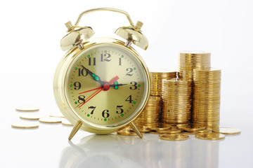 Time is money - clock dial and golden coins