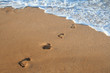 Footprints on the sea's sand