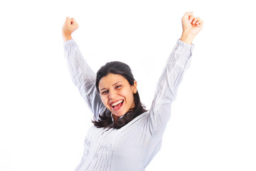 Excited young woman with arms raised in the air