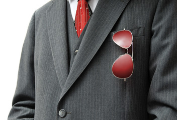 Pair of Red Aviators in Businessman's Pocket