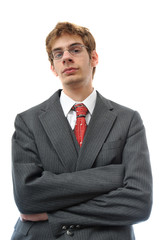 Young adult in suit with arms crossed