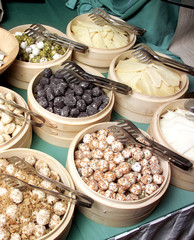 an image of different cheese and olives