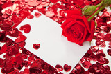 Red rose and blank invitation card