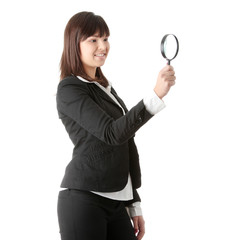 business woman looking into a magniying glass