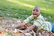 Cute Young African American Boy Having Fun in the Park