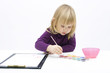 Painting little, blond hair girl on the clipboard