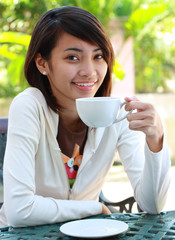 young lady with a cup of coffee