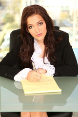Young Entrepreneur at Desk with Notepad
