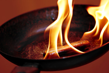 sausage in the flame in frying pan
