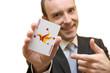 Smiling man showing joker playing card