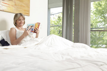 Middle age woman reading a book