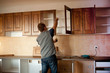 Carpenter working on new kitchen cabinets - 19244262