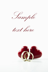 two red hearts with two golden rings- invitation