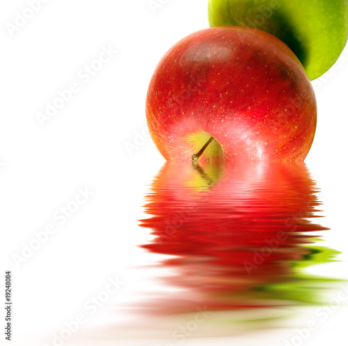 Apples reflecting in to the water