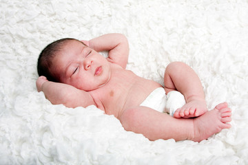 Cute baby asleep on cloud