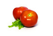 Two tomatoes and a piece of lettuce