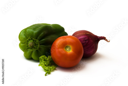 tomato, green pepper, red onion and a piece of lettuce