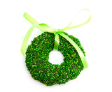 Green speckled christmas candy wreath over white background poster