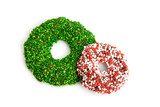Green and colored speckled christmas candy wreath over white poster
