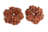 Two speckled chocolate christmas cookies over white background poster